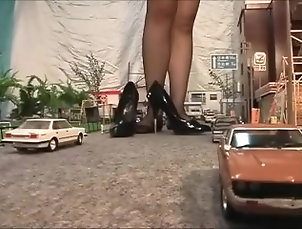 Japanese giantess dominatrix crushing city in heels and stockings