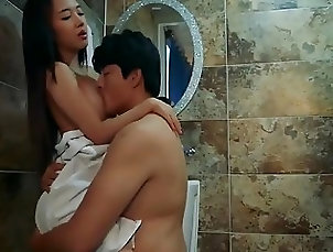 Busty Korean babe and her boyfriend bang in the bathroom
